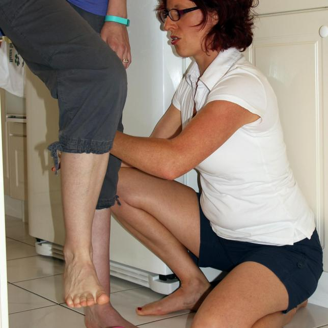 Hands on assistance for supporting leg